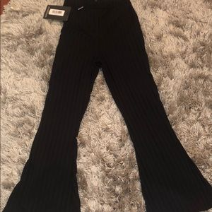 PETITE black ribbed flare pants
